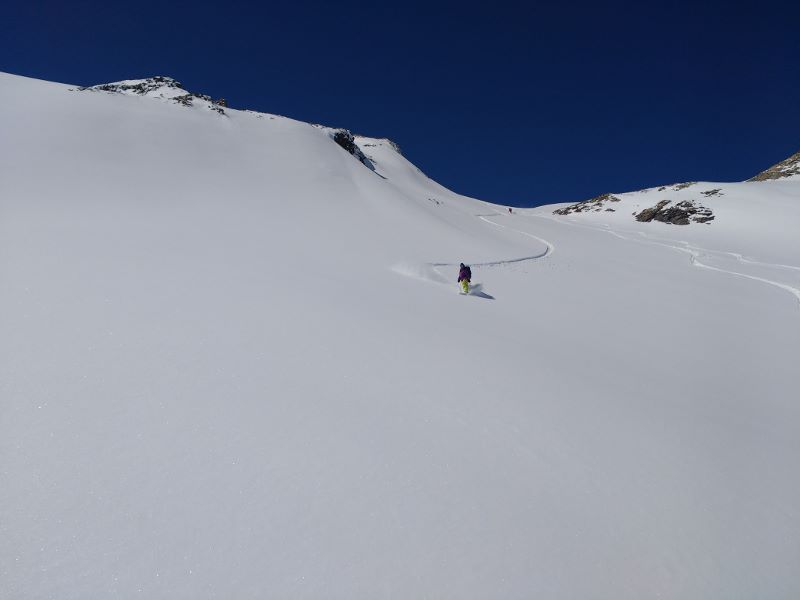 Photo of a lone snowboarder