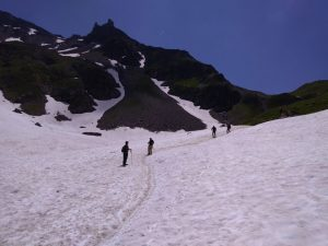 Hikers on snow in the TMB