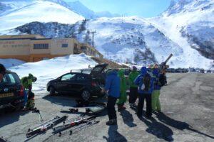 Ski tourers in a car park